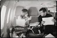 <p>Jane Fonda and author Mark Lane share notes during a flight en route from Los Angeles to San Francisco in 1970.</p>