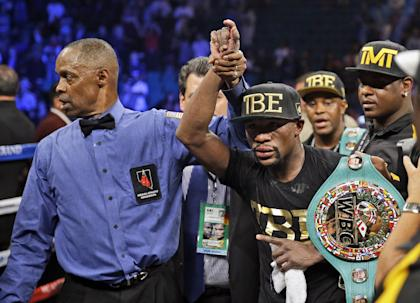 Floyd Mayweather shows off his belts after beating Marcos Maidana on Sept. 13. (AP)