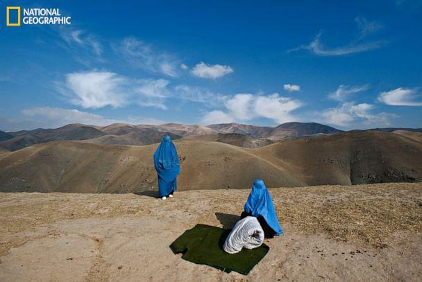PHOTO: Pregnant Noor Nisa, in labor, is assisted by her mother after her car broke down on the way to the hospital in Afghanistan. (Lynsey Addario/National Geographic)