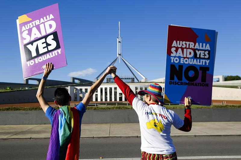 Campaigners in front of Australia's Parliament House in Canberra ahead of the vote on same-sex marriage: AFP/Getty Images