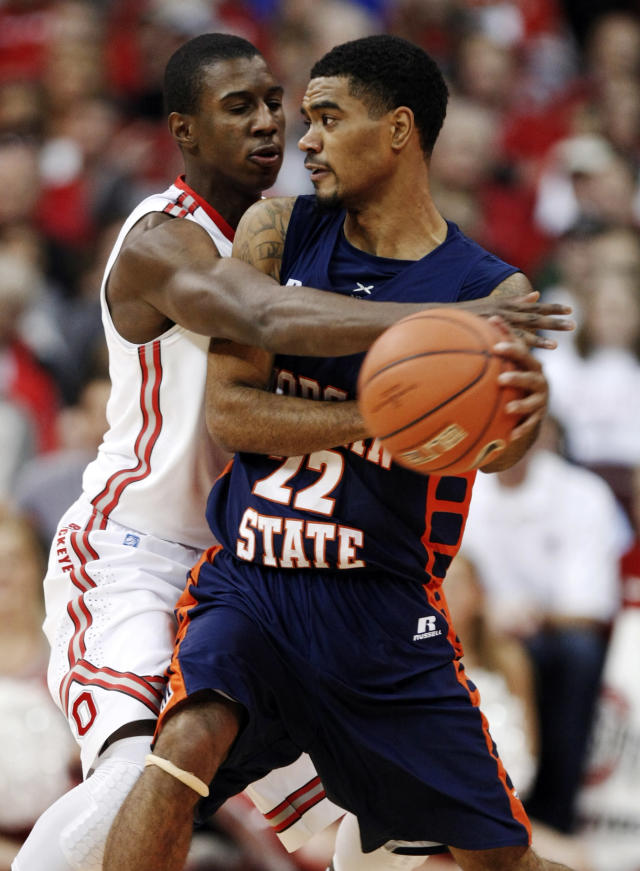 Morgan State's Blake Bozeman, right, looks to pass against Ohio State's Shannon Scott during the first half of an NCAA college basketball game in Columbus, Ohio, Saturday, Nov. 9, 2013. (AP Photo/Paul Vernon)