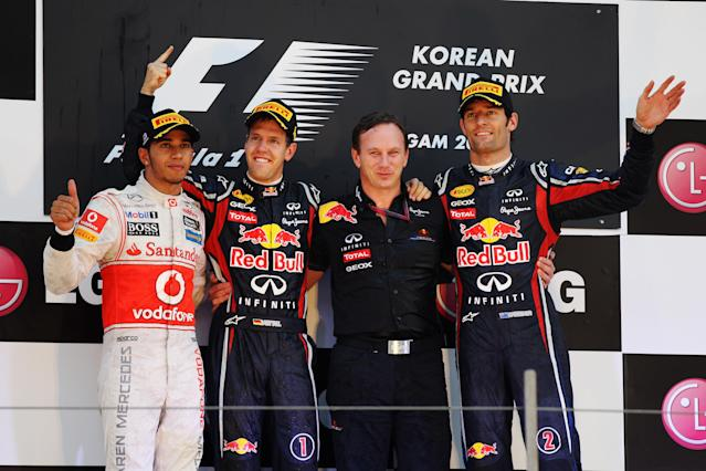 YEONGAM-GUN, SOUTH KOREA - OCTOBER 16: Race winner Sebastian Vettel (2nd left) of Germany and Red Bull Racing celebrates with his Team Principal Christian Horner (2nd right), second placed Lewis Hamilton (left) of Great Britain and McLaren and third placed Mark Webber (right) of Australia and Red Bull Racing following the Korean Formula One Grand Prix at the Korea International Circuit on October 16, 2011 in Yeongam-gun, South Korea. (Photo by Mark Thompson/Getty Images)