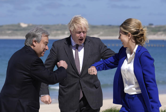British Prime Minister Boris Johnson and his wife Carrie greet United Nations Secretary General Antonio Guterres, left, during arrivals for the G7 meeting at the Carbis Bay Hotel in Carbis Bay, St. Ives, Cornwall, England, Saturday, June 12, 2021. Leaders of the G7 gather for a second day of meetings on Saturday, in which they will discuss COVID-19, climate, foreign policy and the economy. (AP Photo/Kirsty Wigglesworth, Pool)
