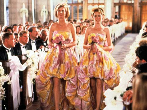 """<div class=""""caption-credit""""> Photo by: Everett Collection</div><div class=""""caption-title""""></div>Julia Roberts's gown in <i>My Best Friend's Wedding</i> wasn't nearly as unfortunate as the floral bubble-mullet dresses her fellow bridesmaids have to wear!"""