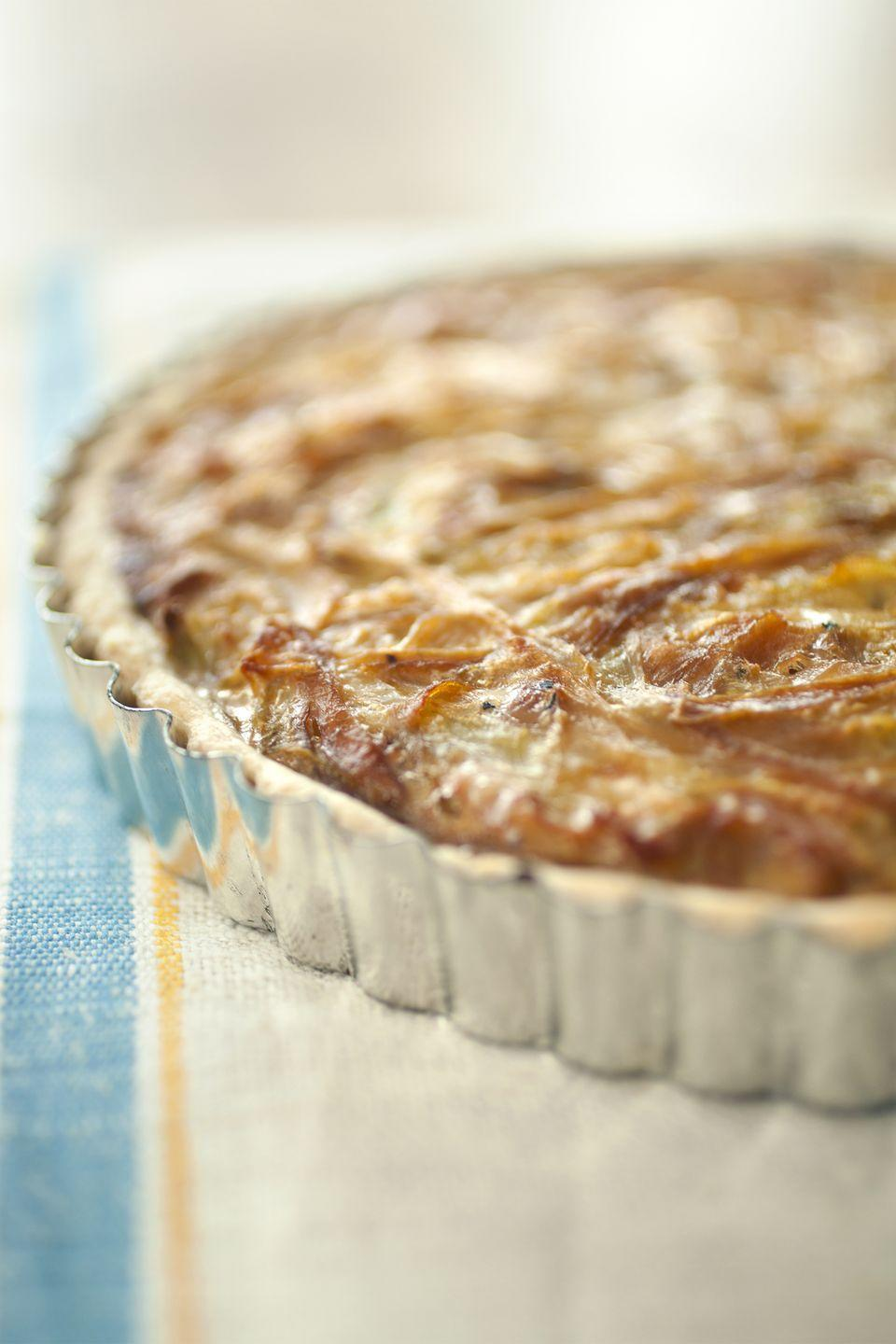"""<p>Rich Gruyère cheese and caramelized onions top this flaky pastry.</p><p><strong><a href=""""https://www.countryliving.com/food-drinks/recipes/a1067/caramelized-onion-gruyere-tarts-3172/"""" rel=""""nofollow noopener"""" target=""""_blank"""" data-ylk=""""slk:Get the recipe"""" class=""""link rapid-noclick-resp"""">Get the recipe</a>.</strong></p>"""