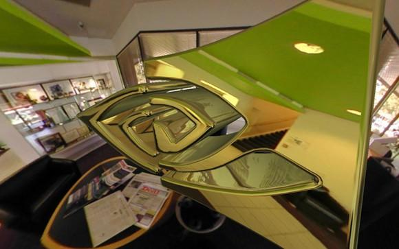 Freeform rendition of the NVIDIA logo, floating in an office environment.