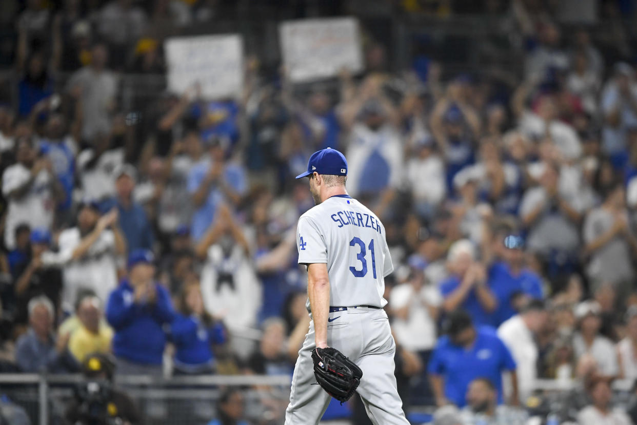 SAN DIEGO, CA - AUGUST 26: Fans cheer as Max Scherzer #31 of the Los Angeles Dodgers leaves the game in  the eighth inning of a baseball game against the San Diego Padres at Petco Park on August 26, 2021 in San Diego, California.  (Photo by Denis Poroy/Getty Images)