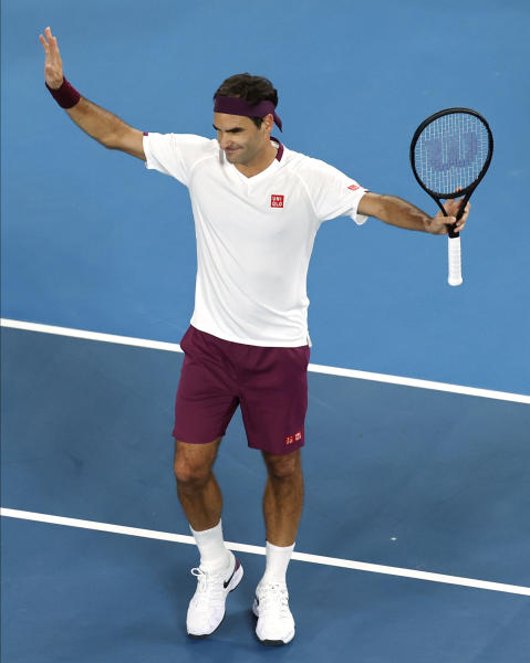 Switzerland's Roger Federer celebrates after defeating Hungary's Marton Fucsovics in their fourth round singles match at the Australian Open tennis championship in Melbourne, Australia, Sunday, Jan. 26, 2020. (AP Photo/Andy Wong)