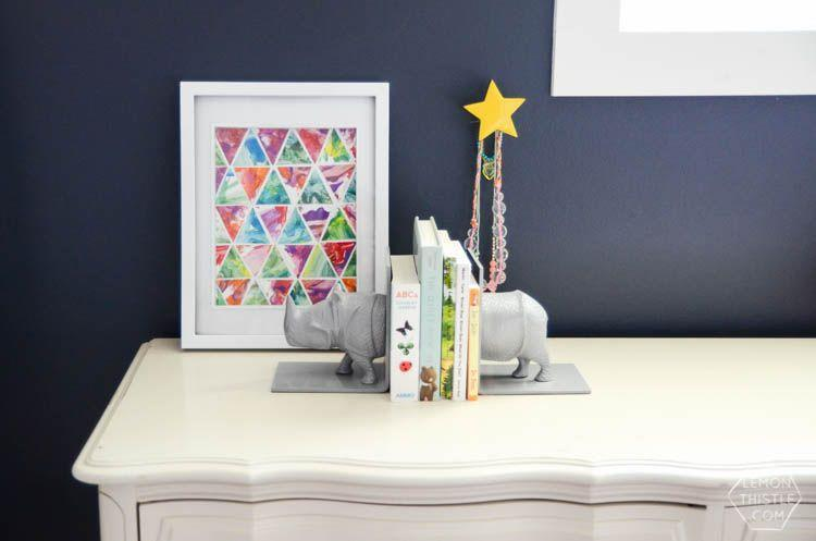 """<p>As much as dad loves the kids' artwork, chances are it's not going to end up framed in his office—unless you help turn it into something a little more elevated, like this finger painting turned geometric work of art. </p><p><a href=""""https://www.lemonthistle.com/geometric-art-finger-paint/"""" rel=""""nofollow noopener"""" target=""""_blank"""" data-ylk=""""slk:Get the tutorial."""" class=""""link rapid-noclick-resp"""">Get the tutorial. </a></p><p><a class=""""link rapid-noclick-resp"""" href=""""https://www.amazon.com/Classic-Frames-matted-Polystyrene-Hanging/dp/B08B3JHQFN?tag=syn-yahoo-20&ascsubtag=%5Bartid%7C10072.g.27603456%5Bsrc%7Cyahoo-us"""" rel=""""nofollow noopener"""" target=""""_blank"""" data-ylk=""""slk:SHOP FRAME"""">SHOP FRAME</a><br></p>"""