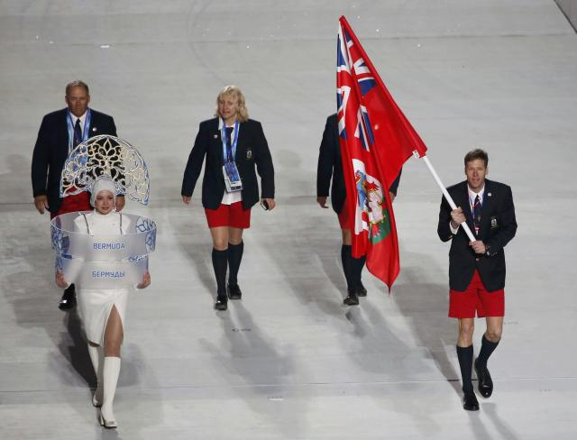 Bermuda's flag-bearer Tucker Murphy leads his country's contingent during the opening ceremony of the 2014 Sochi Winter Olympics, February 7, 2014. REUTERS/Lucy Nicholson (RUSSIA - Tags: OLYMPICS SPORT)