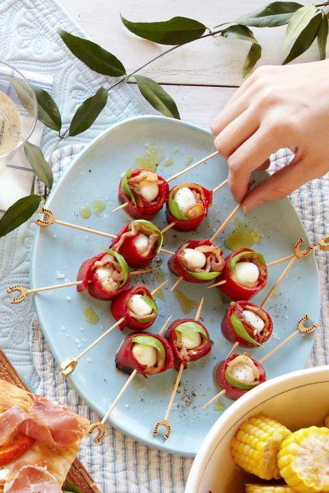 "<p>These skewers are tasty but light, so guests won't fill up.</p><p><strong><a href=""https://www.countryliving.com/food-drinks/recipes/a38084/mozzarella-red-pepper-bacon-skewers-recipe/"" rel=""nofollow noopener"" target=""_blank"" data-ylk=""slk:Get the recipe"" class=""link rapid-noclick-resp"">Get the recipe</a>.</strong></p>"