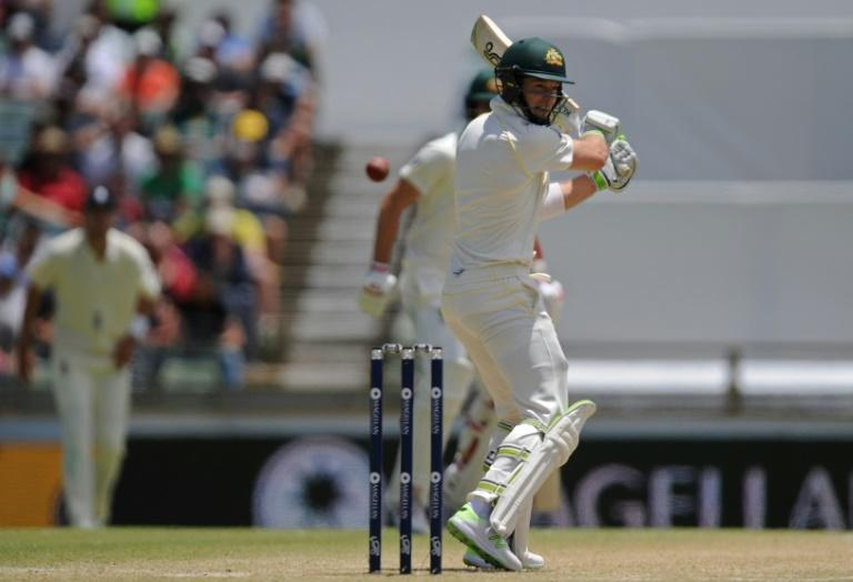 Australia's Tim Paine plays a shot but misses on day four of the third Ashes Test in Perth