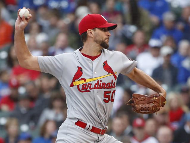 St. Louis Cardinals starting pitcher Adam Wainwright delivers against the Chicago Cubs during the first inning of a baseball game, Friday, Sept. 28, 2018, in Chicago. (AP Photo/Kamil Krzaczynski)