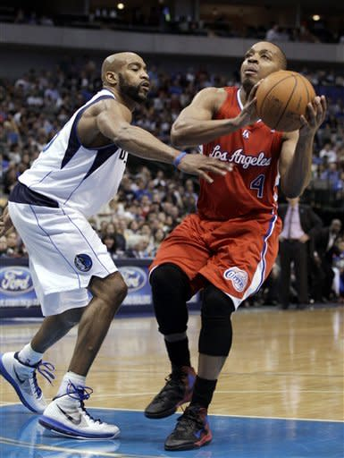 Los Angeles Clippers' Randy Foye (4) drives past Dallas Mavericks' Vince Carter (25) in the second half of an NBA basketball game Monday, April 2, 2012, in Dallas. Foye had a game-high 28-points in the Clippers' 94-75 win. (AP Photo/Tony Gutierrez)