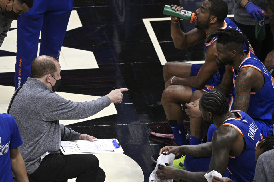 New York Knicks coach Tom Thibodeau, left, gives instructions during a timeout in the second half of the team's NBA basketball game against the Orlando Magic, Wednesday, Feb. 17, 2021, in Orlando, Fla. (AP Photo/Phelan M. Ebenhack)