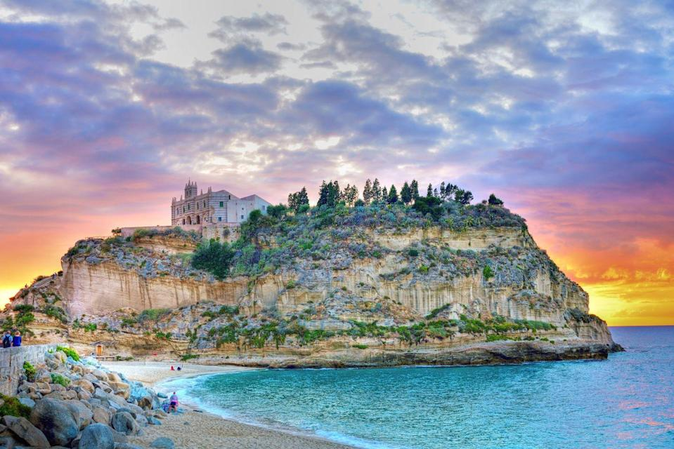 <p>Could that castle on top of a hill be any more picturesque? Located in the toe of Italy's foot, Tropea Beach is set against dramatic rock formations, cliffs, coves, and grottoes, and has sparkling, turquoise, Caribbean-like water.</p>