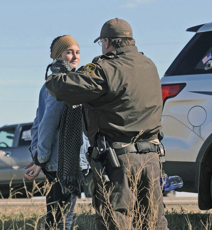 A Morton County Sheriff's deputy officer arrests actress Shailene Woodley at a protest against the Dakota Access Pipeline