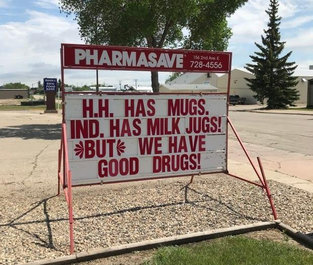 The Pharmasave in Melville, Sask., is among the businesses participating in a good-natured 'sign war,' along with Home Hardware and the local Independent grocery store. (Submitted by Kim Haas - image credit)
