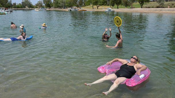 PHOTO: Tricia Watts, right, uses a floaty as she cool off in the water during a heat wave in Lake Havasu, Ariz., June 15, 2021. (Bridget Bennet/Reuters)