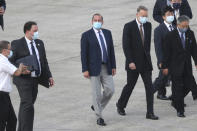 U.S. Health and Human Services Secretary Alex Azar, center, arrives at Taipei Songshan Airport in Taipei, Taiwan, Sunday, Aug. 9, 2020. Azar arrived in Taiwan on Sunday in the highest-level visit by an American Cabinet official since the break in formal diplomatic relations between Washington and Taipei in 1979. (AP Photo/Chiang Ying-ying)