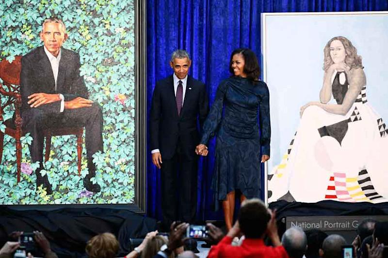 The Obamas selected artists Kehinde Wiley and Amy Sherald for the paintings, which take their place in the National Portrait Gallery's collection of presidential portraits.