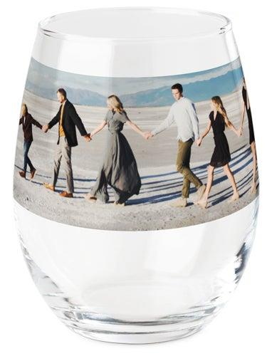 """<h3><a href=""""https://www.shutterfly.com/personalized-gifts/stemless-wine-glass/photo-gallery-wine-glass"""" rel=""""nofollow noopener"""" target=""""_blank"""" data-ylk=""""slk:Shutterfly Photo-Gallery Wine Glass"""" class=""""link rapid-noclick-resp"""">Shutterfly Photo-Gallery Wine Glass</a></h3><br>Gift them a set of stemless glassware that's personalized with their favorite photo (or face). <br><br><strong>Shutterfly</strong> Photo Gallery Wine Glass, $, available at <a href=""""https://www.shutterfly.com/personalized-gifts/stemless-wine-glass/photo-gallery-wine-glass"""" rel=""""nofollow noopener"""" target=""""_blank"""" data-ylk=""""slk:Shutterfly"""" class=""""link rapid-noclick-resp"""">Shutterfly</a>"""