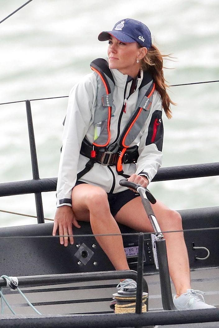 """<p>Kate's the captain now. The Duchess took the helm while competing on behalf of the Royal Foundation at the inaugural <a href=""""https://www.townandcountrymag.com/style/fashion-trends/a28640628/kate-middleton-kings-cup-striped-shirt/"""" rel=""""nofollow noopener"""" target=""""_blank"""" data-ylk=""""slk:King's Cup regatta"""" class=""""link rapid-noclick-resp"""">King's Cup regatta</a>. </p>"""