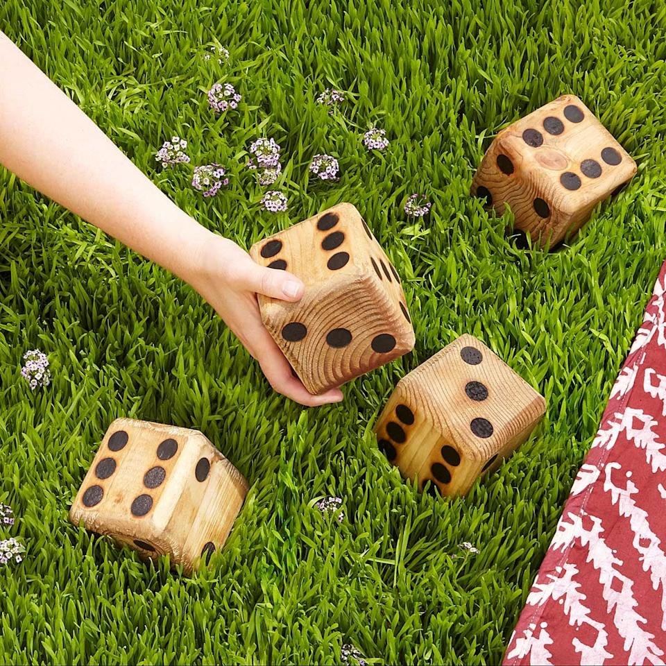 "<p>It's a go big or go home situation with these <a href=""https://www.popsugar.com/buy/Yard-Dice-502692?p_name=Yard%20Dice&retailer=uncommongoods.com&pid=502692&price=50&evar1=moms%3Aus&evar9=26086224&evar98=https%3A%2F%2Fwww.popsugar.com%2Fphoto-gallery%2F26086224%2Fimage%2F46771370%2FYard-Dice&list1=holiday%2Cgift%20guide%2Cparenting%20gift%20guide%2Ckid%20shopping%2Choliday%20living%2Choliday%20for%20kids&prop13=api&pdata=1"" rel=""nofollow"" data-shoppable-link=""1"" target=""_blank"" class=""ga-track"" data-ga-category=""Related"" data-ga-label=""https://www.uncommongoods.com/product/yard-dice"" data-ga-action=""In-Line Links"">Yard Dice </a> ($50), which will certainly foster your family's competitive spirit. </p>"