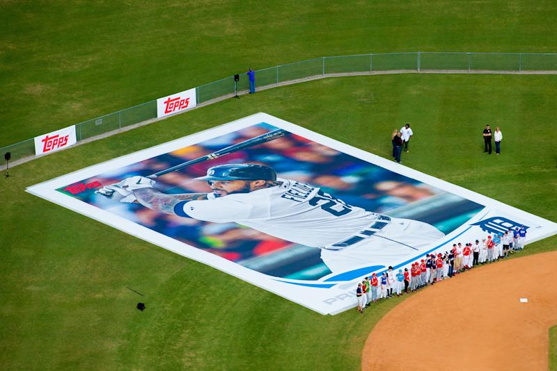 In this image provided by The Topps Company, a 90 feet by 60 feet replica of a baseball card with Detroit Tigers baseball player Prince Fielder's image was unveiled during the announcement of the new 2013 Topps Baseball Series 1 cards, Tuesday, Feb. 12, 2013, in Lakeland, Fla. Fielder was joined by nearly 75 little leaguers from Lakeland City Baseball at the event. (AP Photo/The Topps Company, Chip Litherland)