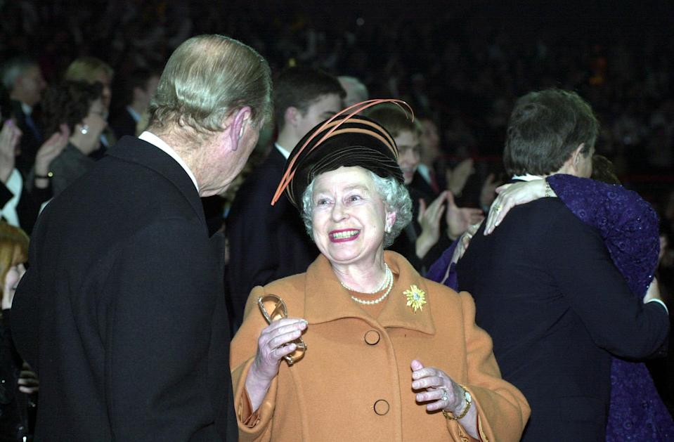 The Queen pictured beaming at her husband as she celebrates with him at the Millennium Dome as the new millennium is ushered in.