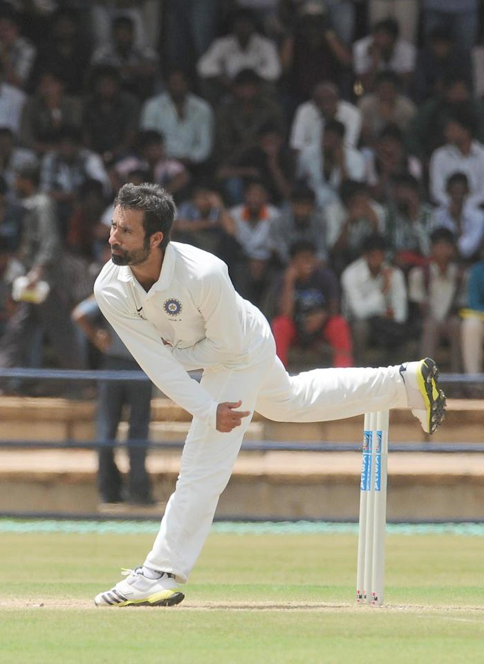 Parvez Rasool of India A bowls en route his five wicket haul against West Indies A on Day 2 of their first Test match at the Gangothri Glades Cricket Ground, Mysore, September 26 2013. (IANS)