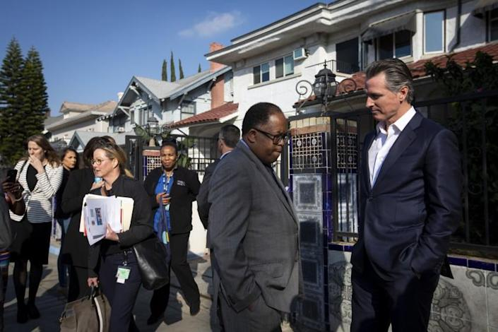 LOS ANGELES, CALIF. - JANUARY 14: Los Angeles County Supervisor Mark Ridley-Thomas, left, and California Gov. Gavin Newsom, right, talk after press confrence at the Lone Star Board and Care in Los Angeles, Calif. on Tuesday, Jan. 14, 2020. Gov. Gavin Newsom is also visiting a board and care as part of his week long homelessness tour. (Francine Orr / Los Angeles Times)
