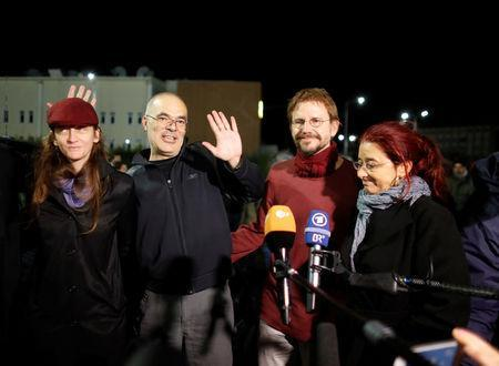 German citizen Peter Frank Steudtner (2nd R) and Swedish citizen Ali Gharavi (2nd L) talk to journalists after being released from the Silivri prison complex near Istanbul, Turkey October 26, 2017. REUTERS/Osman Orsal