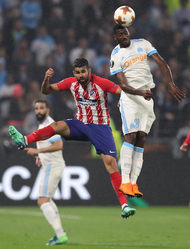 Soccer Football - Europa League Final - Olympique de Marseille vs Atletico Madrid - Groupama Stadium, Lyon, France - May 16, 2018 Atletico Madrid's Diego Costa in action with Marseille's Andre-Frank Zambo Anguissa REUTERS/Peter Cziborra