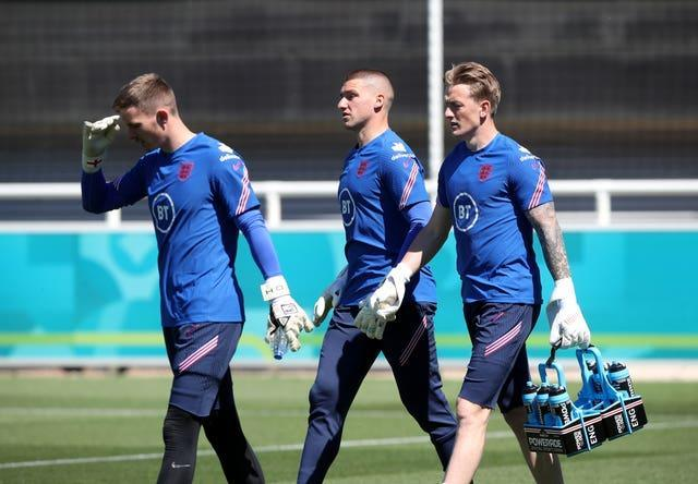 England goalkeepers Dean Henderson, Sam Johnstone and Jordan Pickford head out to training at St George's Park