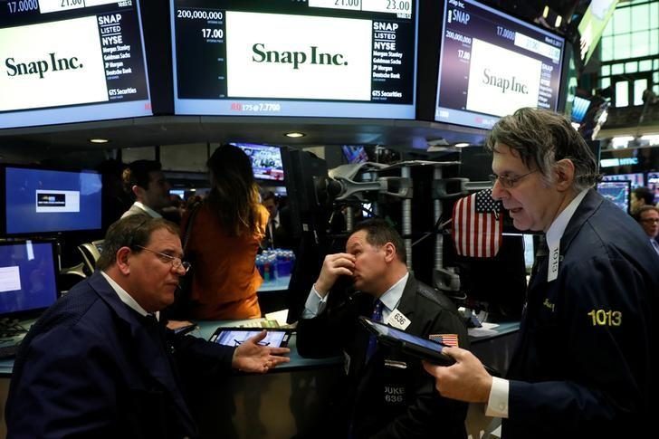 Traders work on the floor of the New York Stock Exchange (NYSE) while waiting for Snap Inc. will post their IPO in New York