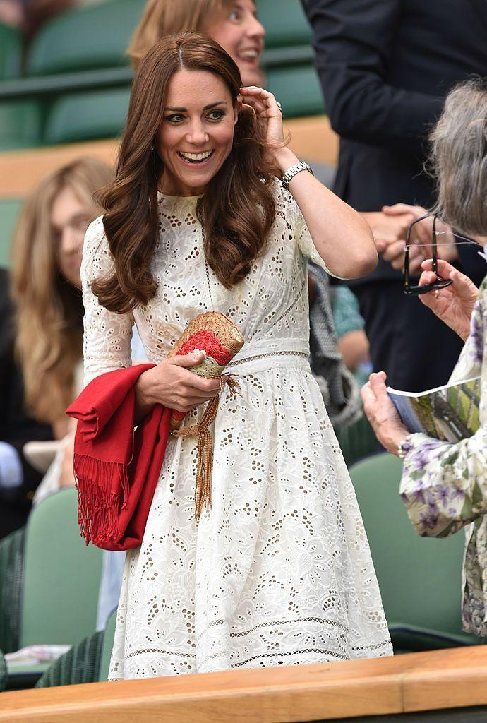 <p>The Duchess of Cambridge accessorised her broderia anglais dress with a woven clutch. </p>