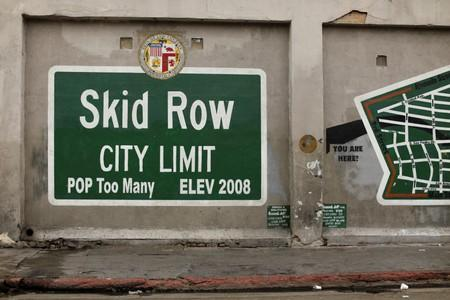 A sign painted on the side of a building marks the skid row area of downtown Los Angeles