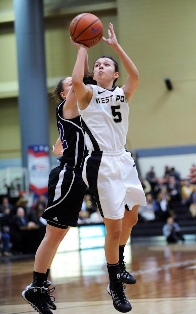 Army's Kelsey Minato (5) takes a shot during the first half of an NCAA college basketball game against Holy Cross in the Patriot League Championship at Christi Arena Saturday, March 15, 2014, at West Point, N.Y. (AP Photo/Karl Rabe)