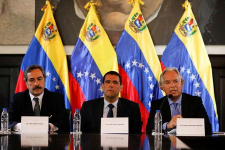 Juan Miguel Matheus (C), deputy of the opposition party Justice First (Primero Justicia), sits next to the lawyers Juan Manuel Rafalli (L) and Eugenio Hernandez-Breton during a news conference in Caracas, Venezuela April 2, 2017. REUTERS/Carlos Garcia Rawlins