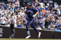 Chicago Cubs' Frank Schwindel rounds the bases after hitting a solo home run during the fourth inning of a baseball game against the San Francisco Giants in Chicago, Friday, Sept. 10, 2021. (AP Photo/Nam Y. Huh)