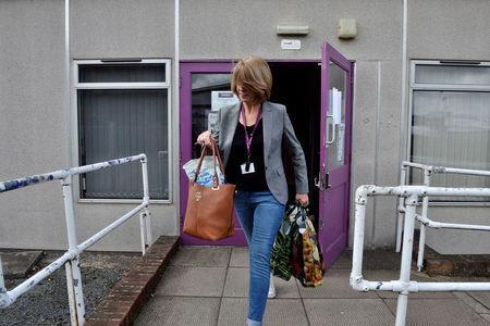 A former employee leaves the Monarch Training Centre, after the airline ceased trading, at Luton airport, Britain October 2, 2017. REUTERS/Mary Turner