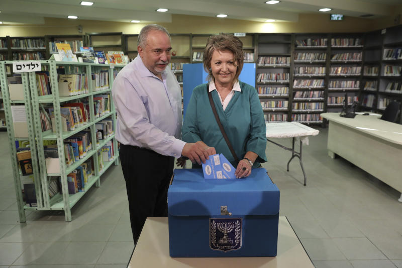 The leader of the Yisrael Beiteinu (Israel Our Home) right-wing nationalist party Avigdor Liberman votes with is wife Ella in the settlement of Nokdim, West Bank, Tuesday, Sept. 17, 2019. (AP Photo/Tsafrir Abayov)