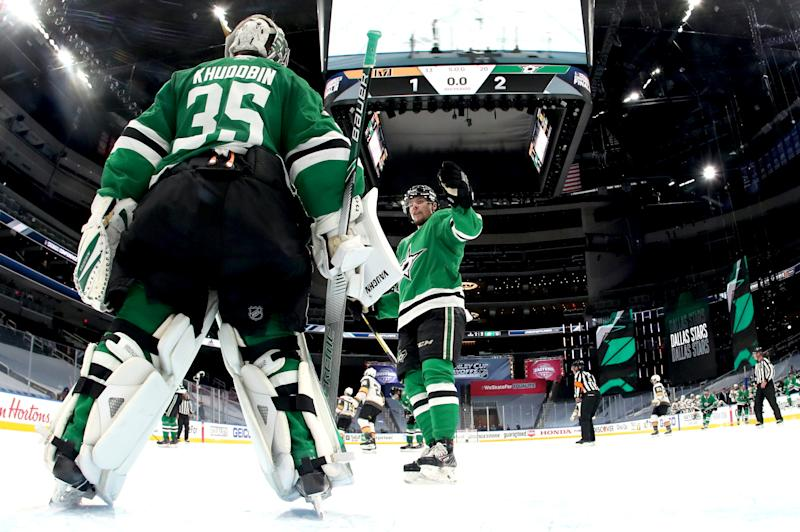 EDMONTON, ALBERTA - SEPTEMBER 12: Goaltender Anton Khudobin #35 of the Dallas Stars is congratulated by Miro Heiskanen #4 after their 2-1 win in Game Four of the Western Conference Final of the 2020 NHL Stanley Cup Playoffs between the Vegas Golden Knights and the Dallas Stars at Rogers Place on September 12, 2020 in Edmonton, Alberta. (Photo by Dave Sandford/NHLI via Getty Images)
