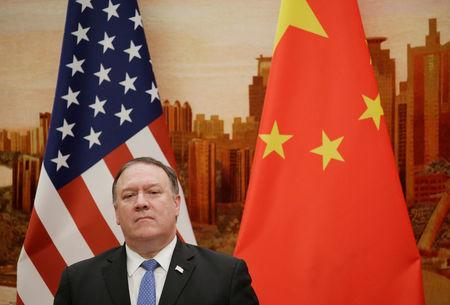 U.S. Secretary of State Mike Pompeo attends a joint news conference with Chinese Foreign Minister Wang Yi in Beijing