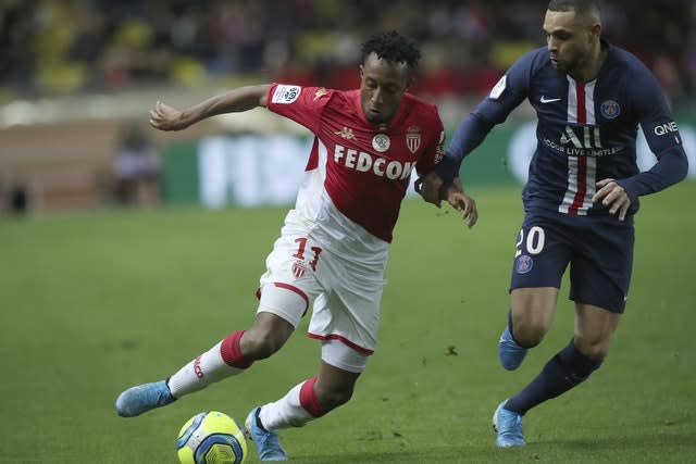 PSG left-back Layvin Kurzawa, right, has been linked with Arsenal (Daniel Cole/AP)