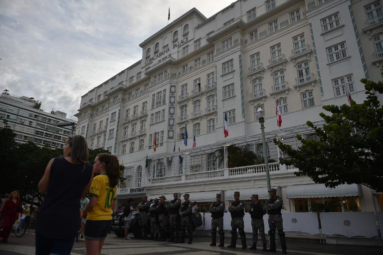 Security personnel stand guard outside the Copacabana Palace Hotel in Rio de Janeiro following the arrest of Ray Whelan, a director of FIFA partner company Match Hospitality, over illegal cup tickets on July 7, 2014 (AFP Photo/Yasuyoshi Chiba)