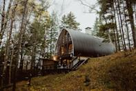 """This family-friendly cabin was built alongside a creek in the White Mountains in the 1960s and has been a hub for multigenerational vacation ever since. With four bedrooms and a total of six beds, the home can comfortably sleep eight, who can spread out between the living room, dining room, deck, and spacious backyard. (There's a plethora of VHS movies and games on hand, too.) While the kitchen doesn't have the most modern appliances, it's perfectly equipped for family dinners. Note: There's only one full bath here and a sensitive water system, another reason to stay here with family comfortable with a more rustic experience. $285, Airbnb (Starting Price). <a href=""""https://www.airbnb.com/rooms/12306988"""" rel=""""nofollow noopener"""" target=""""_blank"""" data-ylk=""""slk:Get it now!"""" class=""""link rapid-noclick-resp"""">Get it now!</a>"""