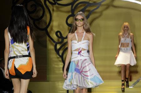 Models present creations from the Versace Spring/Summer 2014 collection during Milan Fashion Week