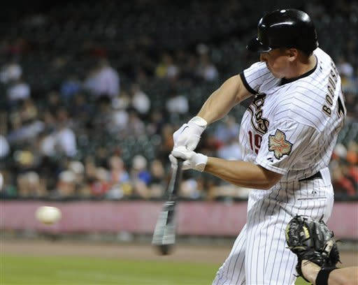 Houston Astros' Brian Bogusevic connects for an RBI double to bring in the go-ahead run against the Miami Marlins in the eighth inning of a baseball game Tuesday, May 8, 2012, in Houston. The Astros won 3-2. (AP Photo/Pat Sullivan)